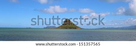 Mokolii, aka Chinaman's Hat. A small tropical island off the coast of Oahu. - stock photo