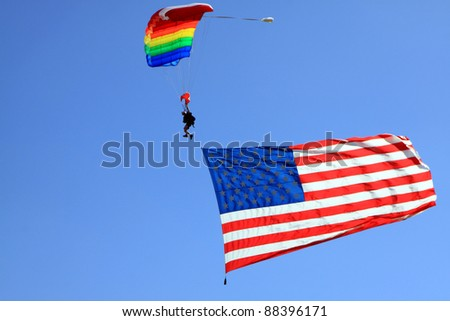 MOKULEIA, HAWAII - JULY 4: A unidentified man from Skydive Hawaii participates in a patriotic ceremony during a polo game at Mokuleia Polo Field on July 4, 2011 in Mokuleia, Hawaii. - stock photo