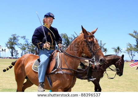 MOKULEIA, HAWAII - JULY 4: An unidentified man in a union soldier uniform participates in the opening day ceremonies for an Independence Day polo game on July 4, 2011 in Mokuleia, Hawaii.