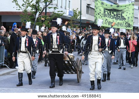 MOLDE - MAY 17: the column of demonstrators in the ongoing national costumes in the Independence Day, May 17, 2008 in Molde, Norway - stock photo