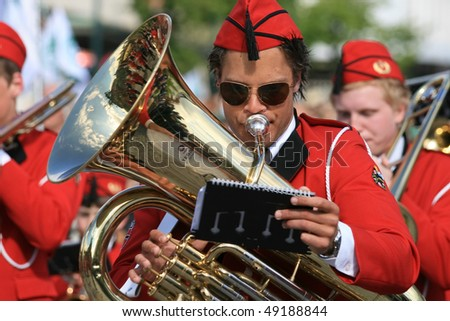 MOLDE - MAY 17: Young man playing the trumpet in the Independence Day, May 17, 2008 in Molde, Norway - stock photo