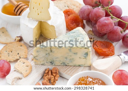 molded cheeses, fresh fruit and snacks, closeup, horizontal - stock photo