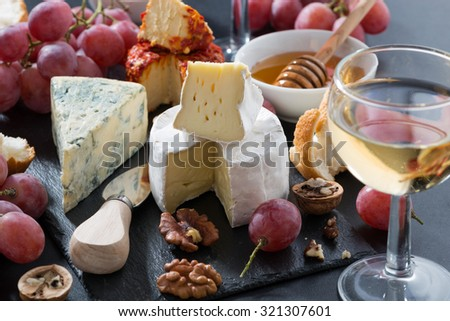 molded cheeses, wine and snacks, closeup - stock photo