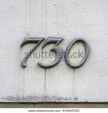 Molded house number seven hundred and thirty - stock photo
