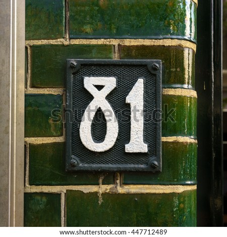molded metal house number eighty one - stock photo