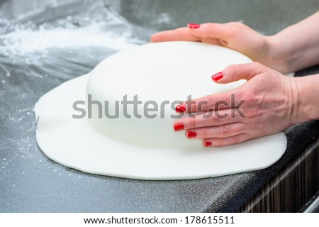 Molding Icing around a fresh cake - stock photo