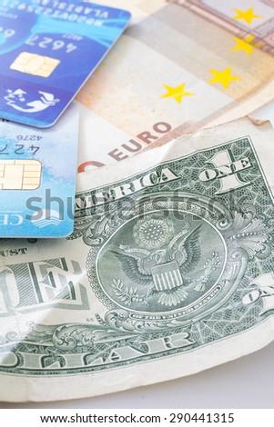 MOLDOVA, CHISINAU, 24.06.2015: VISA CARD WITH DOLLARS ISOLATED ON WHITE BACKGROUND - stock photo