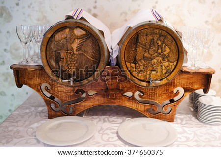Moldova wine with grapevine on background of old wine barrel or Wine cellar - stock photo