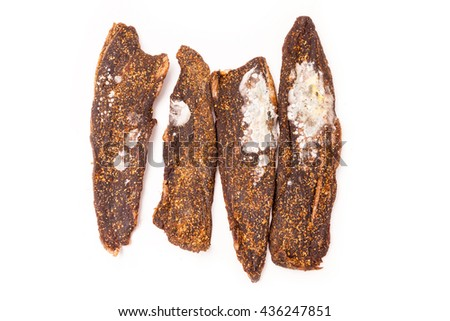 Moldy biltong South African beef jerky isolated on a white studio background. - stock photo