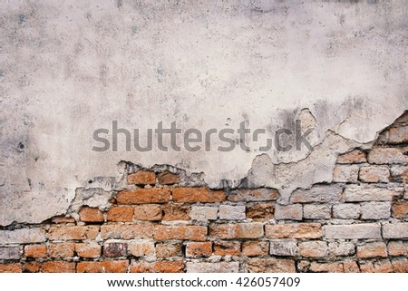Moldy brick wall background ,old wall weathered. - stock photo