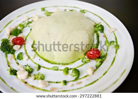 molecular cuisine fish in a dish with beautiful garnish close up - stock photo