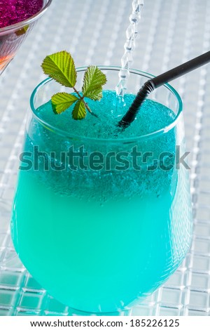 Molecular mixology - Cocktail with blue caracao and whisky - stock photo