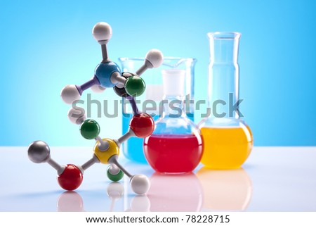 Molecular model and flasks in laboratory - stock photo