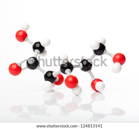 Molecule of fructose or fruit sugar, molecular formula C6H14O6. Carbon represented by the black balls, oxygen by a red ball, Hydrogen by the white balls attached to the carbon or oxygen. - stock photo