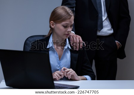 Molesation by boss at workplace - stock photo
