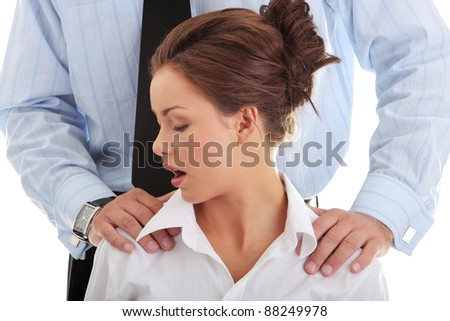 Molestation at work concept. Man molesting woman - stock photo