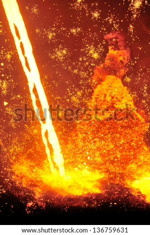 Molten hot steel pouring - stock photo
