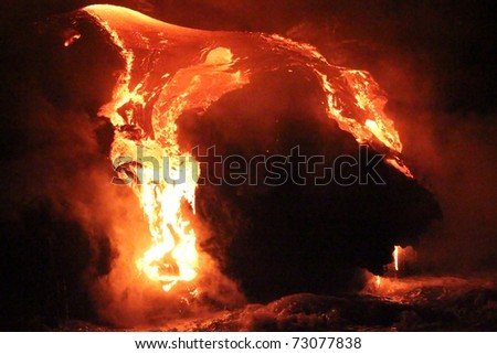 Molten lava flowing from the Big Island of Hawai'i's east rift zone (near Kalapana) into the Pacific Ocean during the early morning. - stock photo