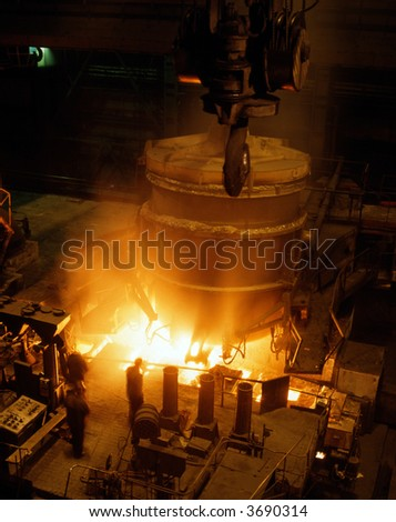 Molten liquid iron is poured. Iron casting. - stock photo
