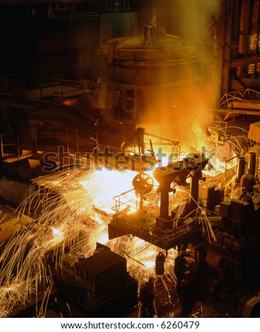 Molten liquid iron is poured. Iron casting. - stock photo
