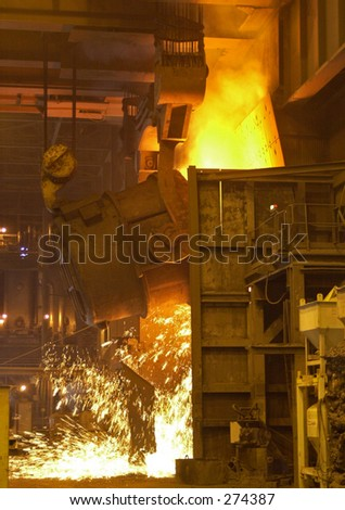 Molten steel pouring. - stock photo