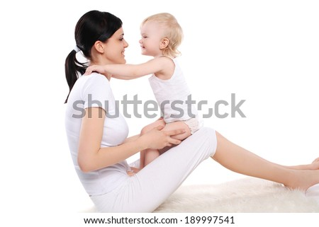 Mom and baby, happy family on a white background - stock photo