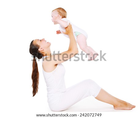 Mom and baby having fun - stock photo