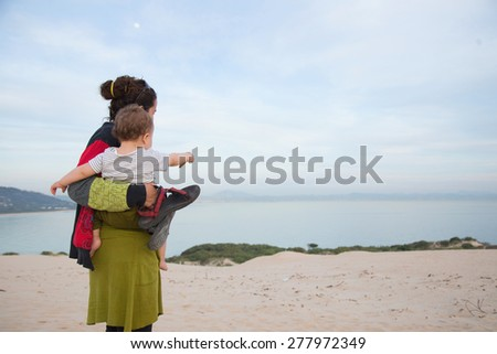mom and baby in the beach - stock photo