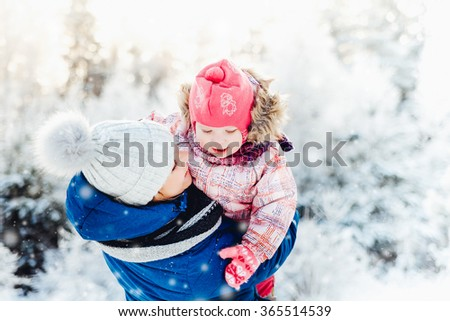 Mom and baby in winter snow