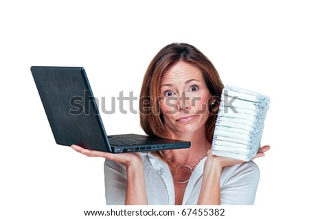 Mom and business woman holds stack of diapers and laptop