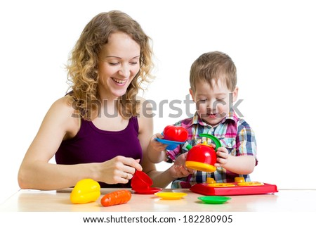 mom and child boy playing together - stock photo