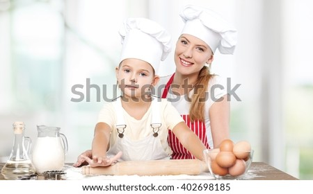 Mom and child cooking.