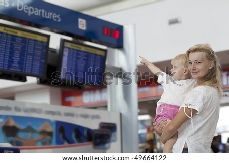 mom and child in the airport - stock photo