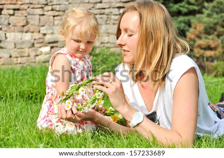 Mom and child together in the park - stock photo