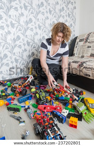 Mom and Children toys on the floor in the room - stock photo