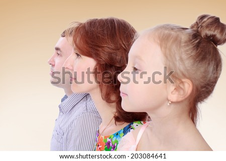 mom and dad daughter portrait in profile.family joy, happy family,happiness concept,happy childhood,carefree childhood,active lifestyle - stock photo