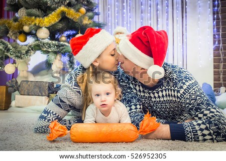 mom and dad kiss. Child waiting for a new year