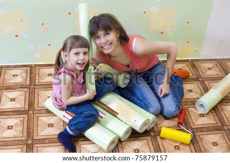 Mom and daughter are doing repairs together - stock photo