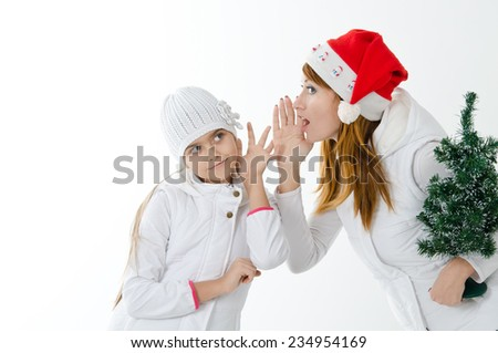 Mom and daughter are preparing for Christmas. joy, surprise. Mom tells daughter secrets, Christmas tree, whisper, white background