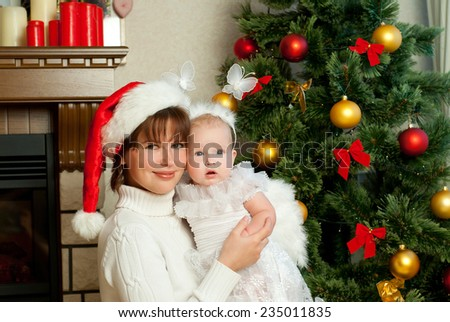 Mom and daughter celebrate Christmas - stock photo