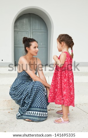Mom and daughter conversation - stock photo