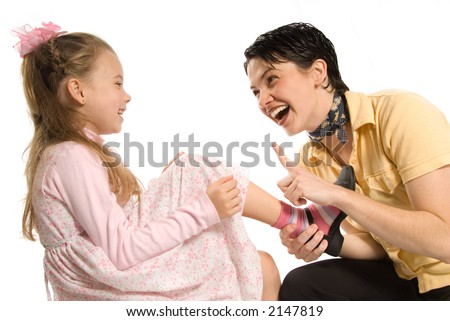 mom and daughter having a blast on white background - stock photo