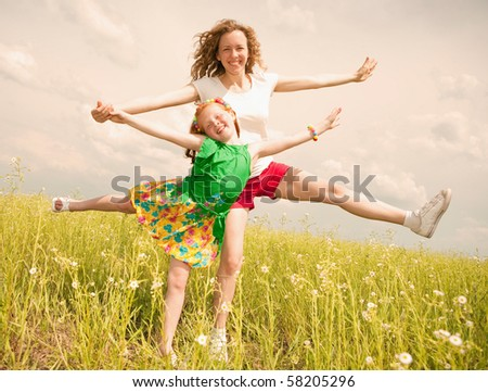 Mom and Daughter Having Fun in the field - stock photo