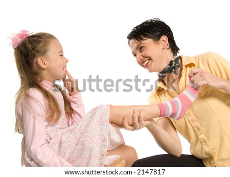 mom and daughter having fun plying dress-up - stock photo