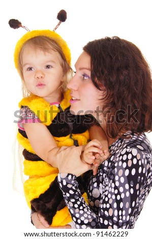 mom and daughter in bee costume on white