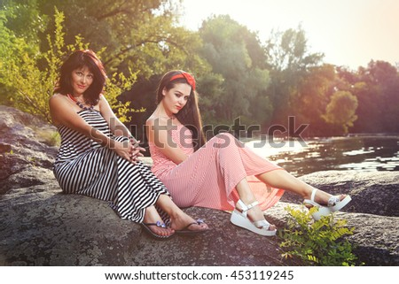 Mom and daughter in nature - stock photo