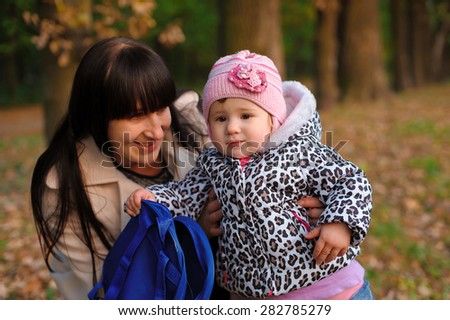 Mom and daughter in the autumn park