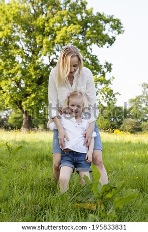 Mom and daughter in the park