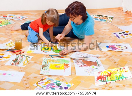 Mom and daughter painted on the floor - stock photo