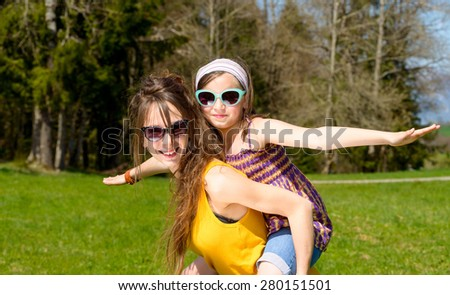 Mom and daughter play in nature